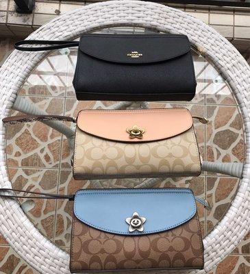 NaNa代購 COACH 39234 72977 新款女士手拿包 手腕包 可放手機 翻蓋手拿包 附購證 買即送禮
