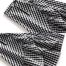 【木風小舖】荷葉交叉造型裙擺 腰綁帶格紋裙*黑白格