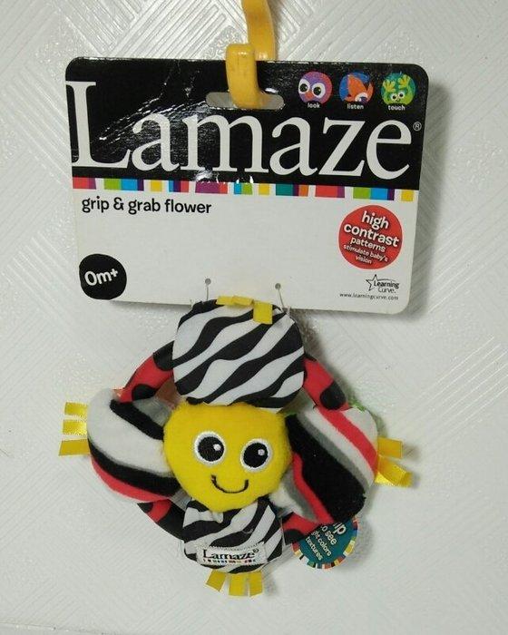 ☆奇奇娃娃(RT)☆Lamaze品牌,雙面花朵手搖鈴,正面是黑白紅三色,背面顏色多彩~150元