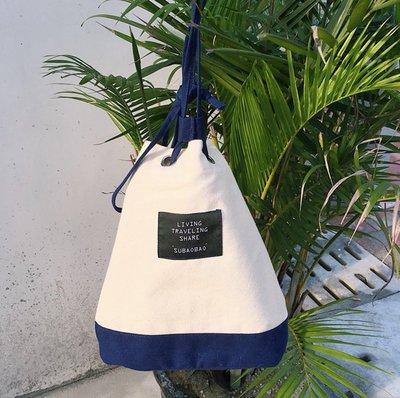 SEYES  街頭個性韓系海洋風拼色束口水桶包