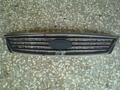 FORD TIERRA-03~06-SE 原廠全新品 水箱罩 $1450 / 標誌另外賣$600