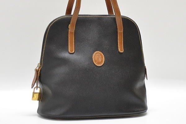 耐看好搭絕版品-知名義大利品牌TRUSSARDI 牛頭牌 黑色真皮 肩背包 側背包 附造型鎖頭~保證真品~低價免郵