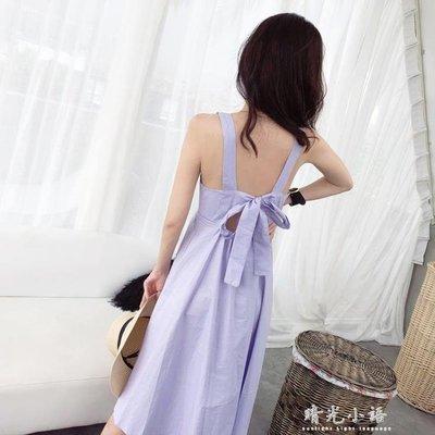 紫色洋裝女夏2018新款設計感背後鏤空蝴蝶結V領吊帶裙沙灘長裙