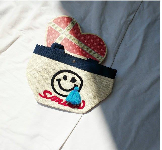 【T3】韓國官網新款可愛笑臉流蘇草編包 吊墜女包 沙灘文藝女式手提包 手拿包 編織包 海灘風 休閒包 生日禮【BS08】