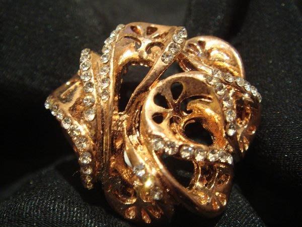 賣家珍藏,全新粉紅金色藝術花水鑽戒指,很美喔,低價起標無底價!本商品免運費!