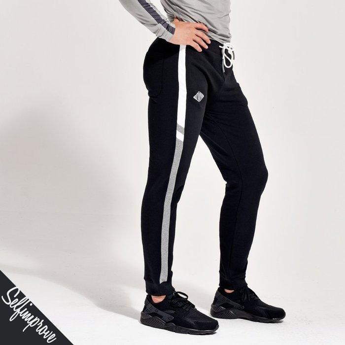 【OTOKO Men's Boutique】固制:彈力拼條合身運動褲/黑色(台灣獨家代理)
