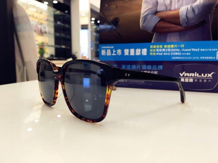 J'ADORE 雙色搭配設計太陽眼鏡 流動的線條與堅硬材料搭配 讓眼鏡隨著臉的線條建立不同風格