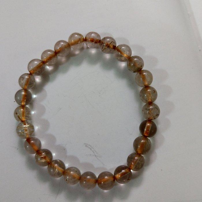 【開運如意閣】J362天然水晶~鈦髮晶約7mm*25顆圓珠手鍊-手圍約17公分~招財.護身.增人緣
