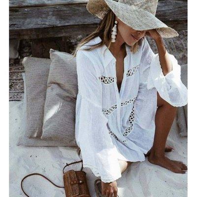 寶島小甜甜~Hollow out the horn sleeve beach blouse is prevented bask in