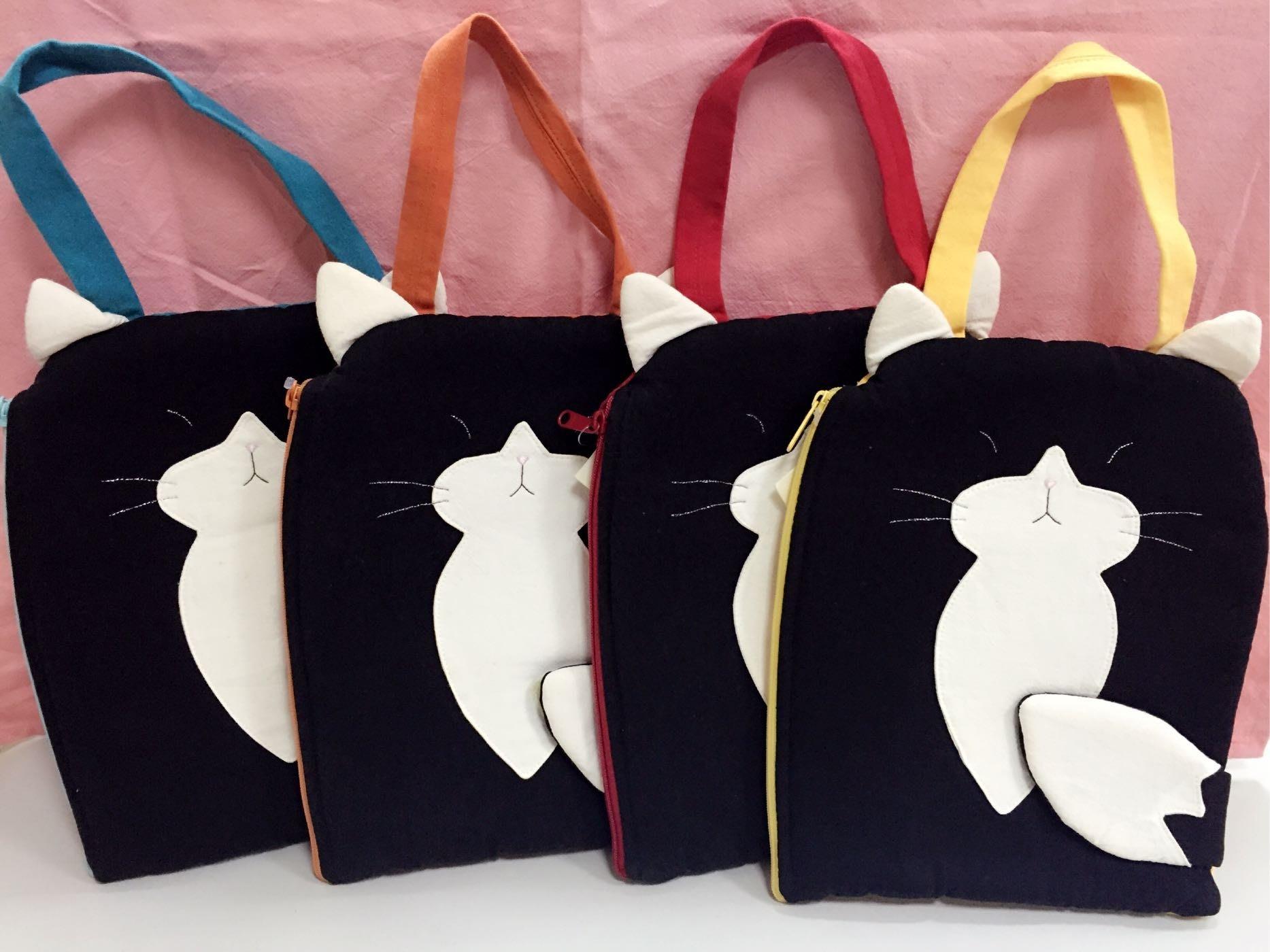 日本卡拉貓~人氣黑貓咪防水平版收納包 iPad mini