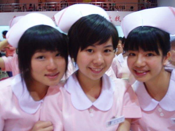 199免運*水手服專賣店*台中護專護校生護士服一 套~(粉紅橘白荷葉領上衣+護士白褲 )