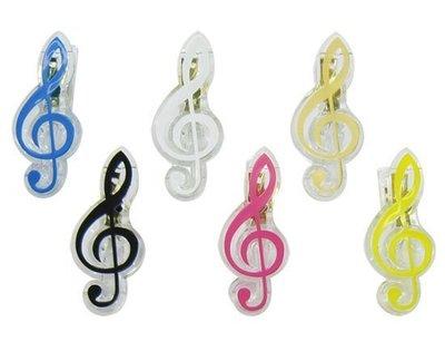 【華邑樂器98002-3】 高音符號樂譜夾-透明黃色 (尺寸:7x2.8x2.8cm)
