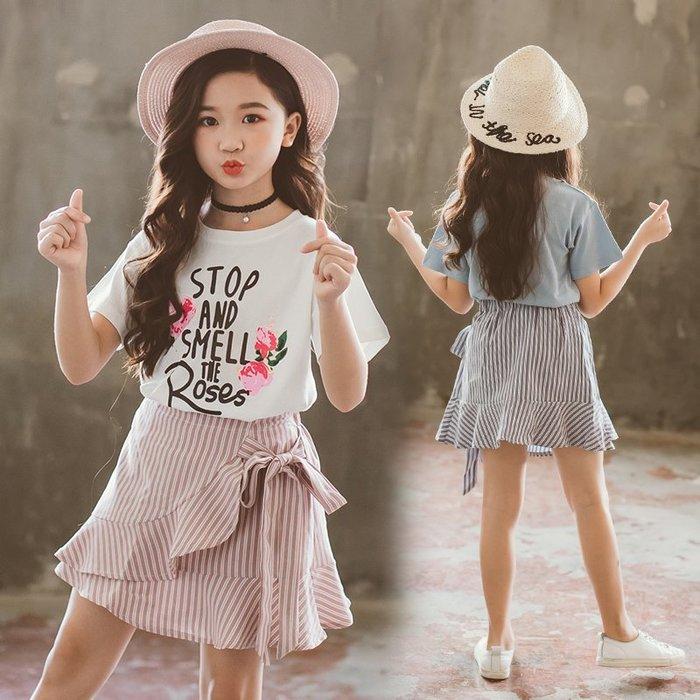 [C.M.平價精品館]新品特價/100~150/一衣多穿印花棉質T恤+別緻斜紋綁帶短裙二件式套裝  小童/中大童