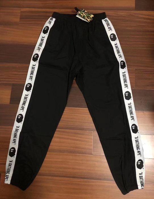 日本bathing ape新款BAPE源人頭串連標布織帶黑色長褲運動褲