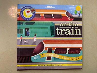 on the Train (A SHINE-A-LIGHT Book)