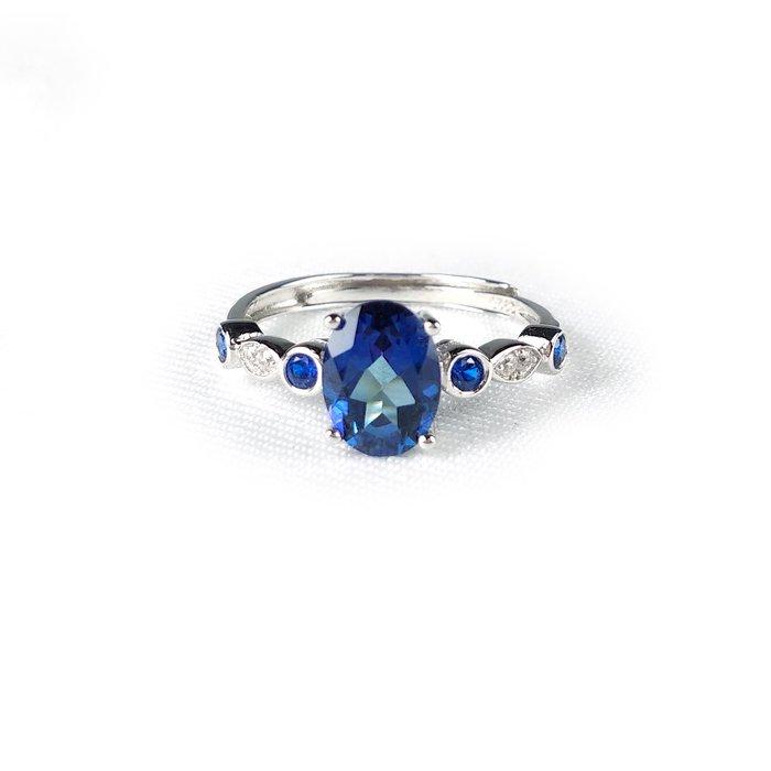 《博古珍藏》925純銀鑲藍托帕石戒指.內徑17.4mm.戒圍可自行調整.飾品配件.節慶禮物.附包裝盒.底價回饋