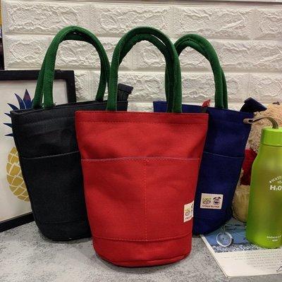 6色日系簡約文青素色圓筒帆布袋水桶包便當袋手提袋媽媽包購物袋逛街小包包多口袋撞色提把午餐包餐具袋百搭