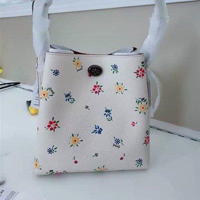 【八妹精品】COACH 1041 新款女士碎花小號水桶包 女式手提包 單肩背包 斜跨包側背包