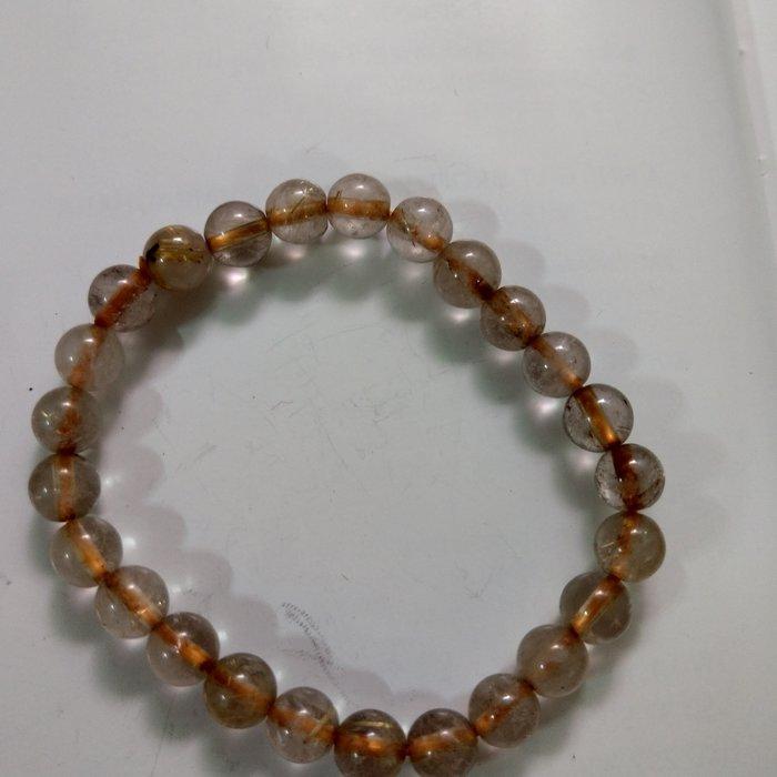 【開運如意閣】J392天然水晶~鈦髮晶約7mm*25顆圓珠手鍊-手圍約17公分~招財.護身.增人緣