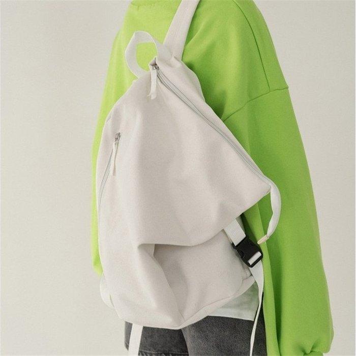 SeyeS   韓系百搭基本款二色率性不規則設計感雙肩後背包(男女皆可)