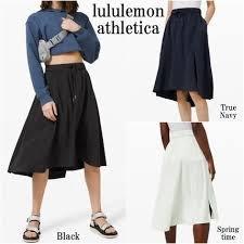 全新真品~~Lululemon Time to Flounce Skirt (顏色: 深藍; size: 6)