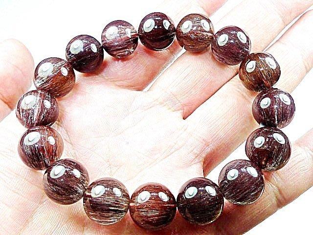 (( 上品堂))頂級銅鈦髮晶手珠.收藏款~貓眼全順絲,磁場超強,重達57克.只給第一標.