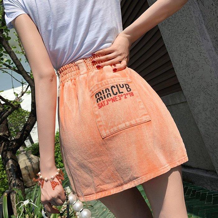 《巴黎拜金女》橙色牛仔裙修身百搭顯瘦拉鍊a字半身裙短