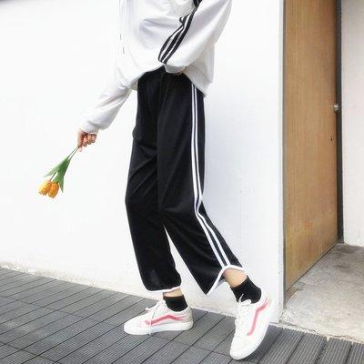 春季女裝韓版寬松側條紋休閑褲子女學生百搭顯瘦九分闊腿褲潮