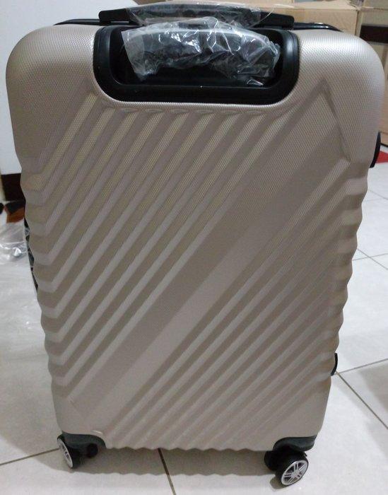 全新  24吋ABS斜紋香檳金硬殼四輪行李箱  購買價:1199 元