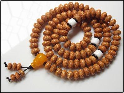 【藏傳|佛教文物】 天然特潤天竺龍珠菩提 血絲龍珠菩提( 10.5*7mm ) 108顆佛珠 實物拍攝 ~152460