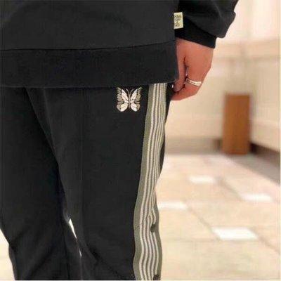 NEEDLES 側邊排扣蝴蝶刺繡織帶復古休閒秋冬寬鬆長褲運動