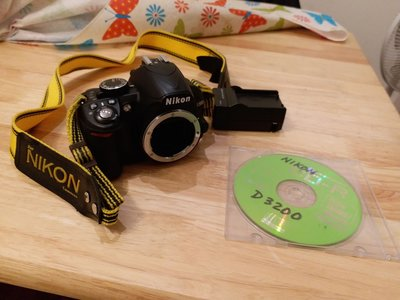 Nikon D3100 with battery charger and manual eye piece out of order other fun ok