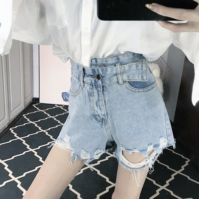 日韓女裝 洋裝 T恤 女褲 2019新款時尚韓版氣質個性不規則腰頭破洞顯瘦毛邊短褲女潮春夏季