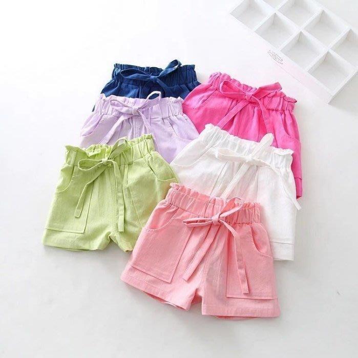 小確幸衣童館OM770 夏季女童棉麻純色蝴蝶結繫繩大口袋短褲 藍色/桃紅現貨特價
