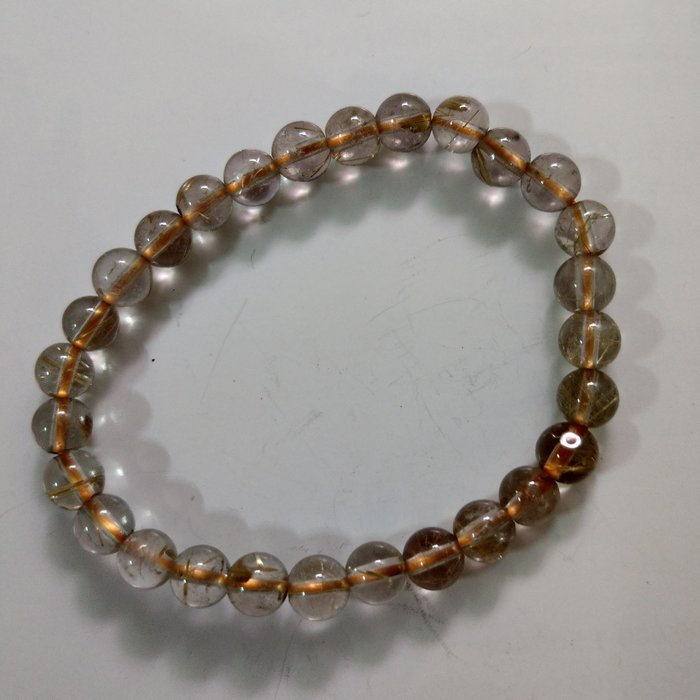 【開運如意閣】J363天然水晶~鈦髮晶約6.5mm*28顆圓珠手鍊-手圍約17.5公分~招財.護身.增人緣
