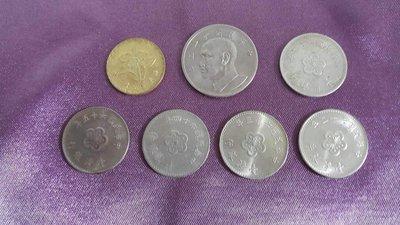 中華民國舊錢幣七枚,民國62年伍圓,伍角各一枚,民國49年一枚,民國62~65壹圓各一枚共七枚