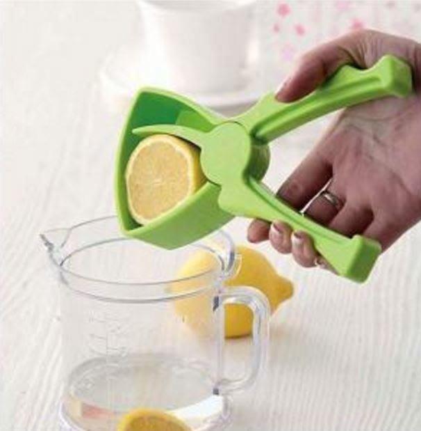創意家居 迷你手動檸檬榨汁器水果橙子榨汁機 49元
