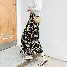黃色花黑裙
