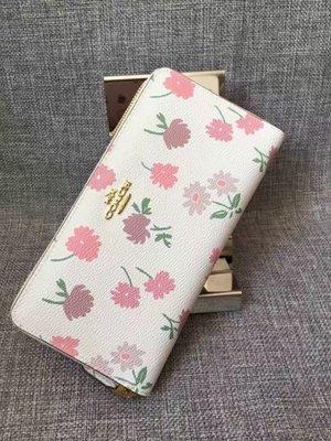 (Outlet特惠)COACH 55881 新款女士碎花設計拉鏈長款皮夾 手拿包 內置12個卡位 附購買證明